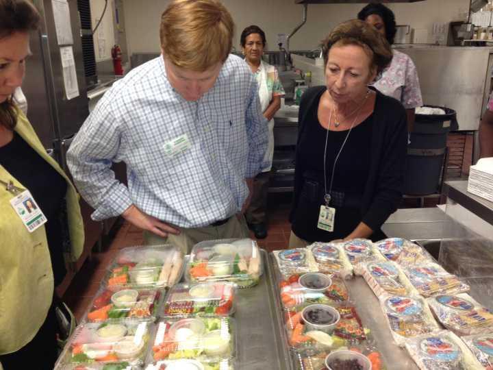 Adam Putnam inspecting school lunch trays