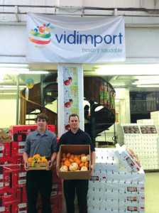 Darren (left) and Dylan Wells focus on foreign markets with their mini pumpkins. Photo credit: Wells family