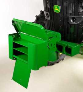 The new Tractor Toolbox attaches easily to the front weight support of the tractor and has more room for tools, hitch pins, and other essential items. Photo credit: John Deere