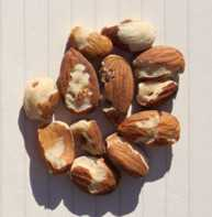 Navel orangeworm-damaged kernels are easily evident by a visual inspection. (Photo credit: Wes Asai)