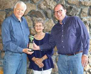 Bill and Jeannette Evans receive the award for Apple Growers of the Year from American and Western Fruit Grower editor David Eddy.