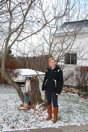 I posed for a photo with the tree in Nova, OH. (Photo credit: Regina Herrick)