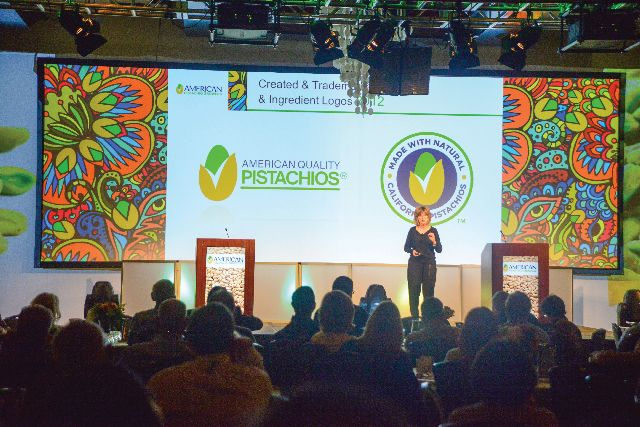 Judy Hirigoyen, the director of Global Marketing for American Pistachio Growers, addresses the annual conference.