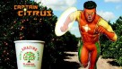Captain Citrus running through an orange grove