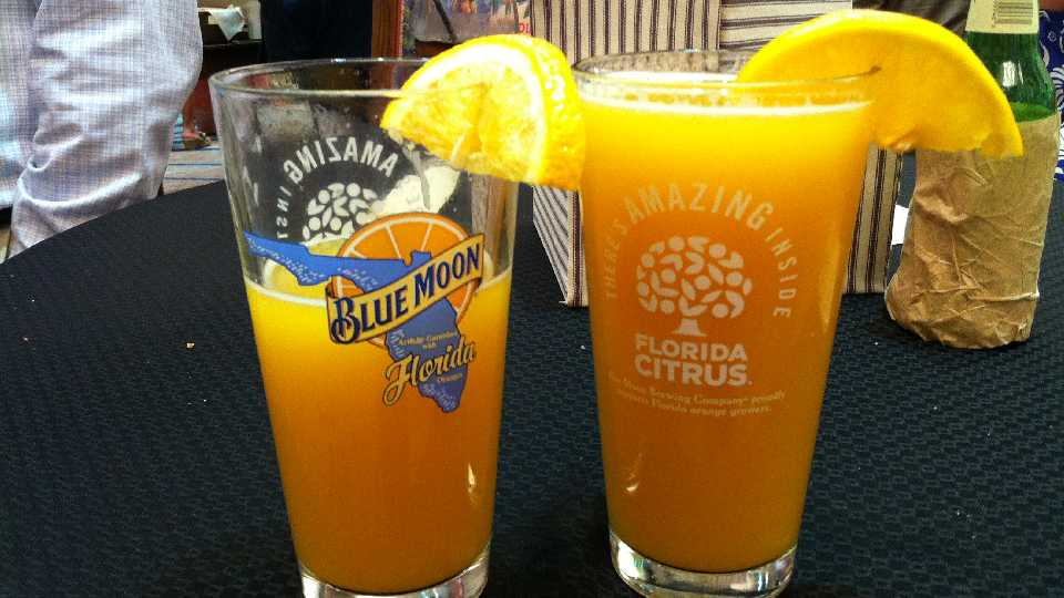 """The """"BeerMosa,"""" featuring Florida orange juice and slice, teamed with Blue Moon Brewing Co. ale"""