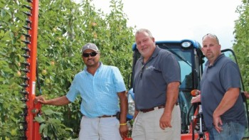 Jose Iniguez, Rod Farrow, and Jason Woodworth, co-owners of Lamont Fruit Farms in Waterport, NY, have maximized the art of profit per acre. (Photo credit: Christina Herrick)