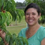 Mercy Olmstead picking peaches