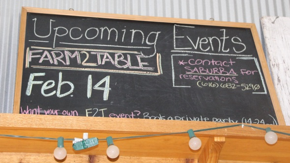 This sign at Sietsema Orchards in Ada, MI, advertises the next farm-to-table dinner. (Photo credit: Christina Herrick)