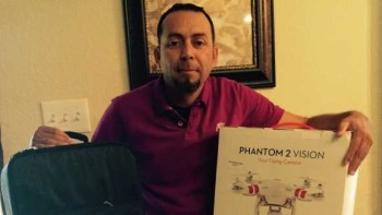 Jesus Luna, Meister Media Worldwide Phantom 2 Quadcopter giveaway winner, posing with his new prize