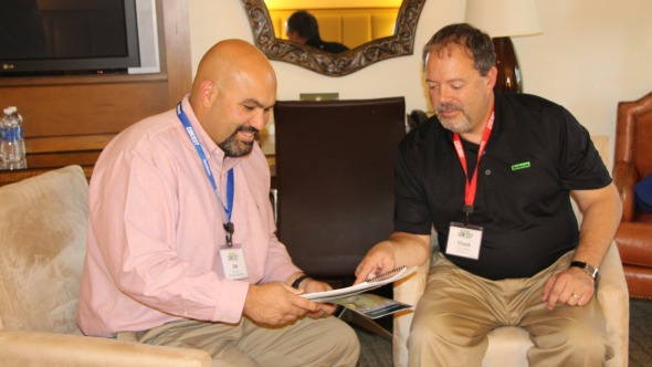 Joe Ferrari from Dole and Liphatech's Chuck Hathaway discuss strategy at the VegetableGrowerConnect in Sand Diego in November.