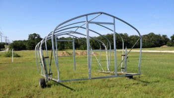 Movable high tunnels, like the one pictured here, will provide growers more flexibility and versatility, and allow them to use the entire growing season for crops. Photo credit: Noble Foundation