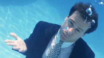 Guy in suit under the water