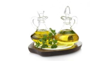 two glass goblets of olive oil