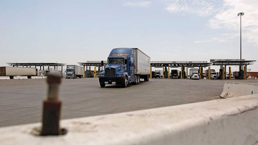 semi trucks at border crossing