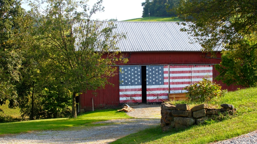 American flag on barn. Photo by Cam Miller FEATURE