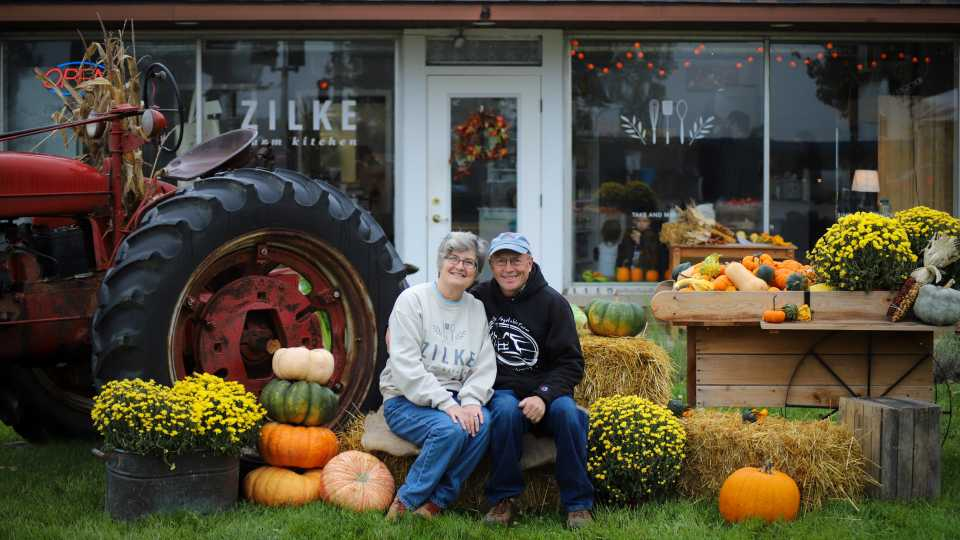 Tom and Vicki Zilke in front of Zilke Farm Kitchen